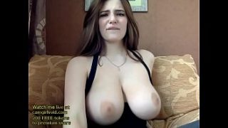 Russian beauty plays with her huge boobs